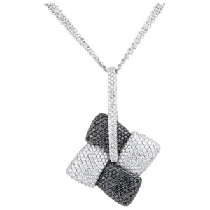 Elegant pave dia pendant + necklace in 18k gold with appx 5 cts white dias and 4.7 cts black dias